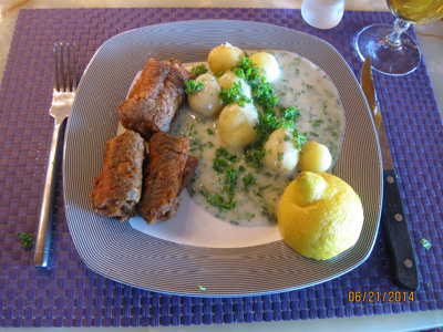 Fried eel with boiled potatoes in white parsley sauce