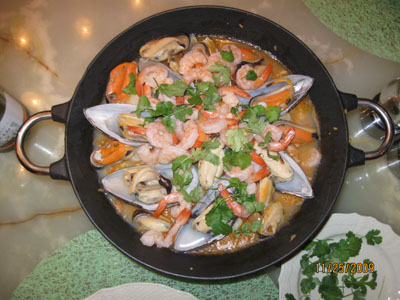 Fish paella made in a Paellepan and in a wokpan