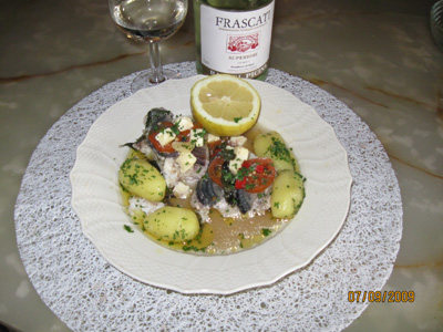 Cod baked in aluminium foil with Feta cheese and culinary herbs