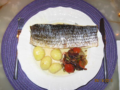 Baked mullet on herbs