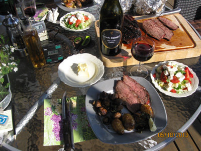 Roast rump steak on the grill with accessories
