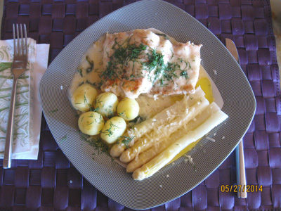 Baked haddock with white asparagus, new potatoes and dill sauce